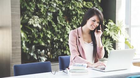 woman-phone-professional-computer-desk